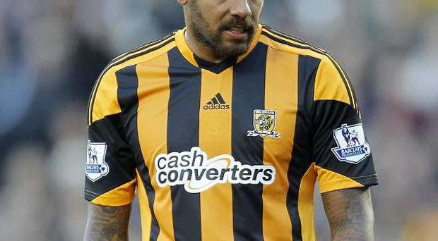 Tom Huddlestone, pictured, has been tipped to go to Brazil by former team-mate Wayne Routledge