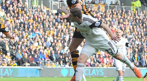 George Boyd heads in the only goal the game for Hull against Swansea