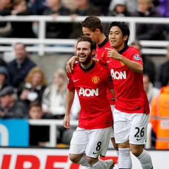 Juan Mata, left, wants Manchester United to improve at Old Trafford