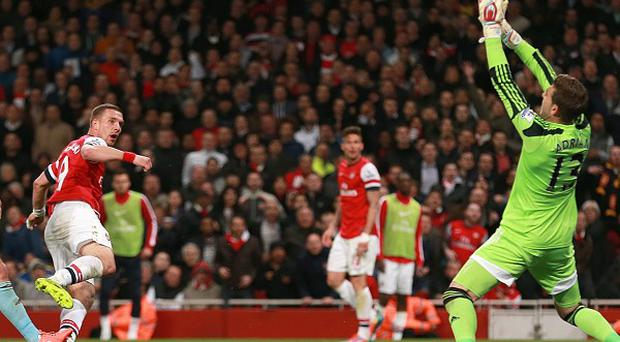 Arsenal's Lukas Podolski struck twice to help the Gunners to victory