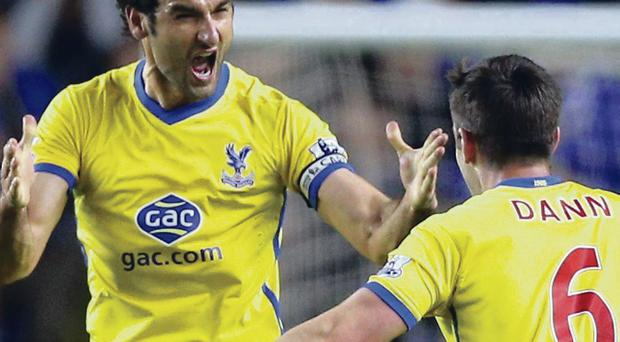 Get in: Mile Jedinak (left) and Scott Dann celebrate Crystal Palace's third goal against Everton at Goodison Park last night