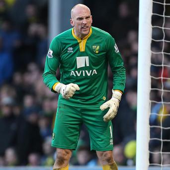 Norwich goalkeeper John Ruddy has challenged his team-mates to raise their game against league leaders Liverpool