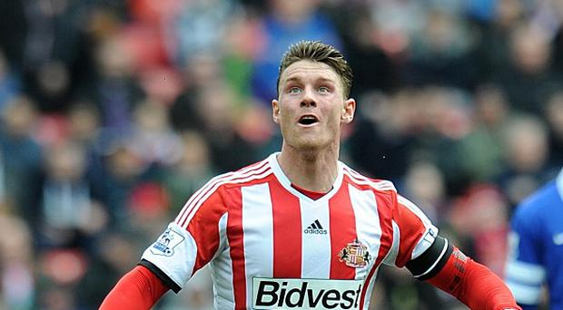 Connor Wickham netted twice for Sunderland in their draw with Manchester City