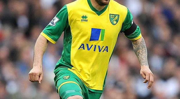 Midfielder Bradley Johnson has called for Norwich to make things