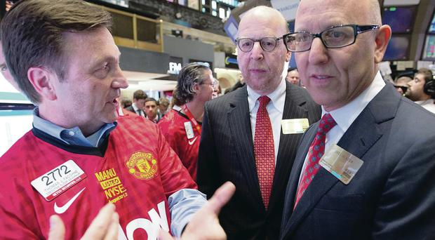 Manchester United owners Joel (right) and Avram Glazer talk to a Manchester United fan at the New York Stock Exchange