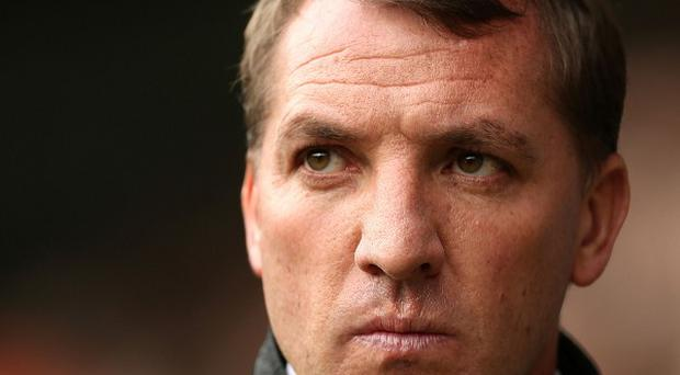 Liverpool manager Brendan Rodgers claims the club's owners Fenway Sports Group are delighted with the progress made at Anfield