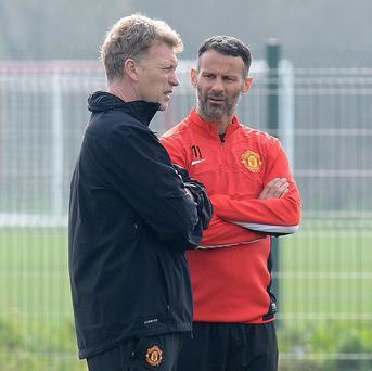Ryan Giggs, right, will take charge of Manchester United this weekend