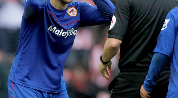 Cardiff defender Juan Cala reacts to being sent off at Sunderland