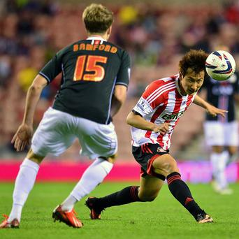 Sunderland are unlikely to face further action for fielding Ji Dong-won, right, with incomplete registration