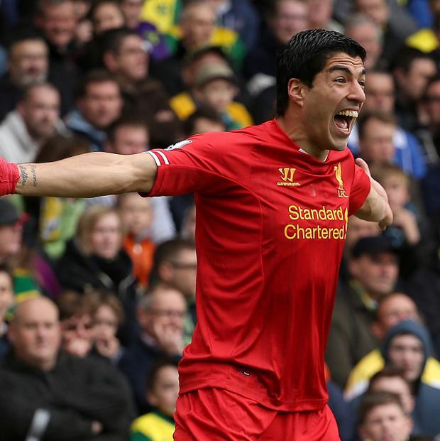 Luis Suarez celebrates one of his 30 goals this season