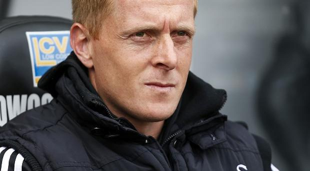 Garry Monk, pictured, has been appointed Swansea's permanent manager after signing a three-year deal