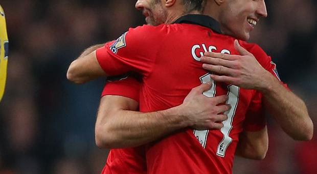 Robin van Persie, right, has been impressed with Ryan Giggs, left, during his brief time in charge