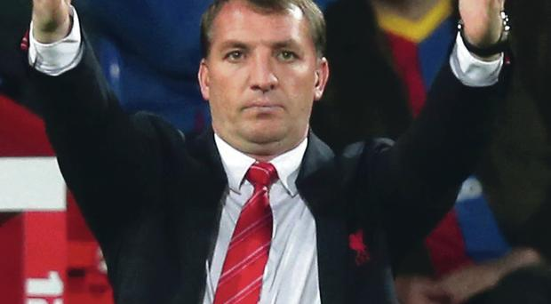 Learning curve: Liverpool boss Brendan Rodgers believes his side will emerge stronger from their late title slip-up