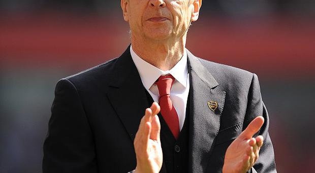 Arsene Wenger believes Arsenal are not far away from Manchester City's level