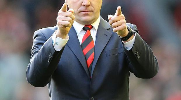 Malky Mackay has reached a settlement with Cardiff over his sacking from the club