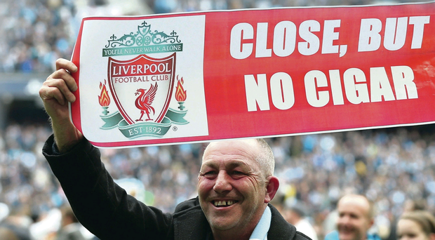 So near: A Manchester City fan revels in the failure of Liverpool to win the league titl