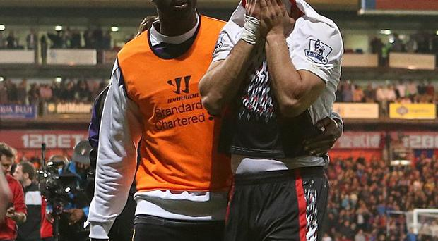 Kolo Toure, left, believes the pain of missing out on the Premier League title this season will drive them on in the next campaign