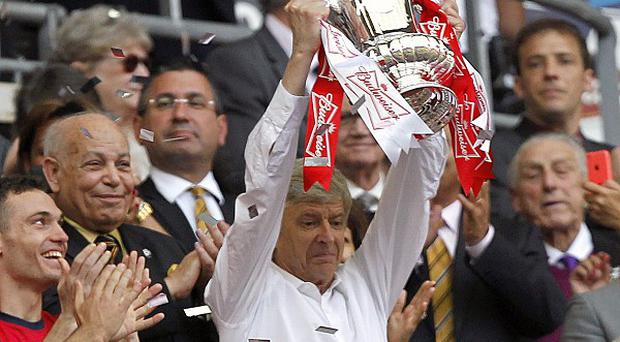 Arsenal manager Arsene Wenger guided his team to FA Cup success at Wembley
