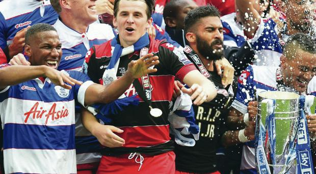 Premiership bound: Joey Barton celebrates with his QPR team-mates at Wembley after their play-off victory over Derby County