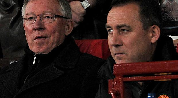Rene Meulensteen, right, was a first team coach at Manchester United under Sir Alex Ferguson, left