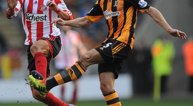 Ignacio Scocco, left, has struggled to force his way into the Sunderland team