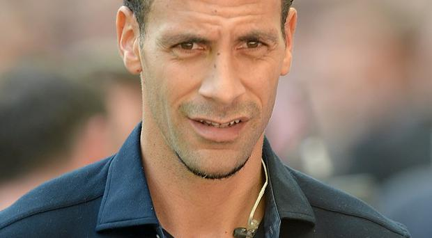 Rio Ferdinand, pictured, would keep Luis Suarez at Anfield if he were Liverpool boss Brendan Rodgers