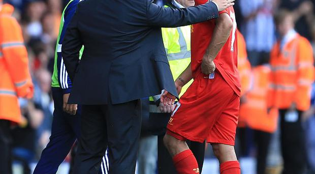 Brendan Rodgers, left, is confident Liverpool will continue to improve without Luis Suarez, right