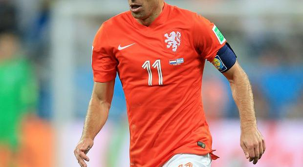 Arjen Robben, pictured, said he is not going to follow Holland manager Louis van Gaal to Manchester United