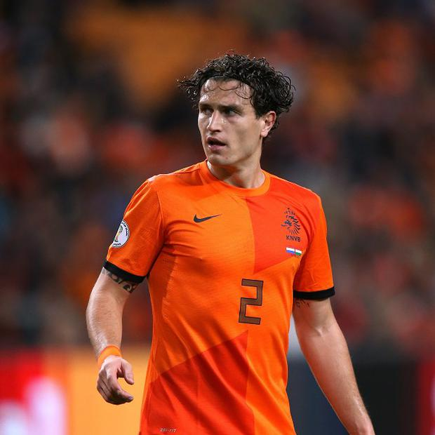 Daryl Janmaat has penned a six-year contract with Newcastle