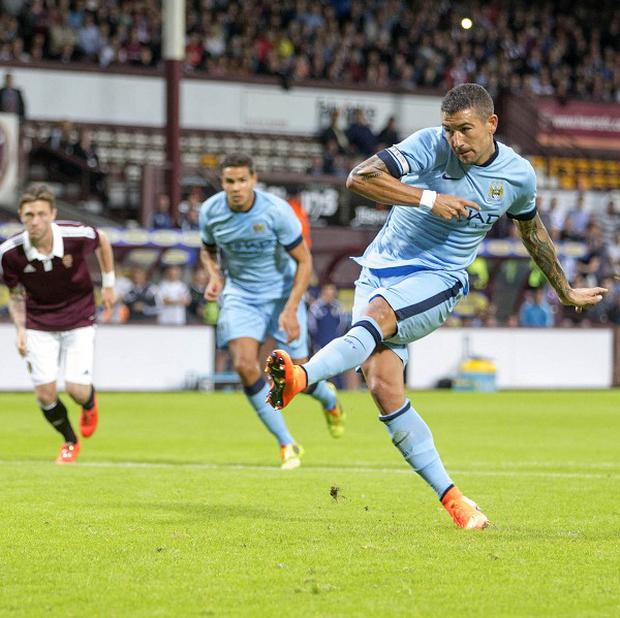 Aleksandar Kolarov, right, nets Manchester City's winner against Hearts