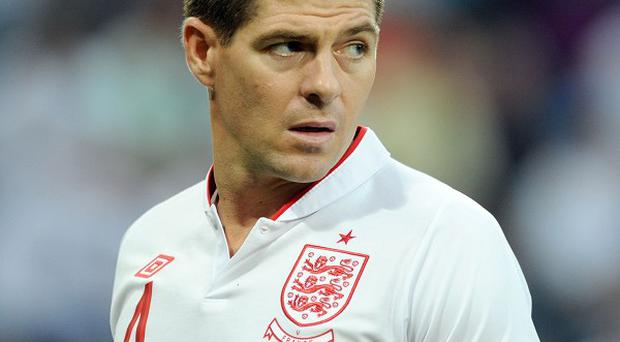 Former team-mate Jamie Carragher is confident the decision made by Steven Gerrard, pictured, to retire from international football will benefit club Liverpool