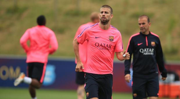 Gerard Pique, pictured, was told by Louis van Gaal that he was not strong enough to be a centre-half