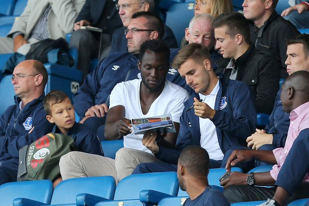 Everton's new signing Romelu Lukaku signs autographs during the pre-season friendly between Everton and Porto at Goodison Park