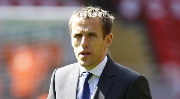 Phil Neville believes David Moyes had a tough job in charge of Manchester United