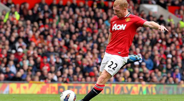 MANCHESTER, ENGLAND - APRIL 08: Paul Scholes of Manchester United scores his team's second goal during the Barclays Premier League match between Manchester United and Queens Park Rangers at Old Trafford on April 8, 2012 in Manchester, England. (Photo by Alex Livesey/Getty Images)