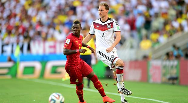 Christian Atsu, left, played for Ghana at the World Cup in Brazil