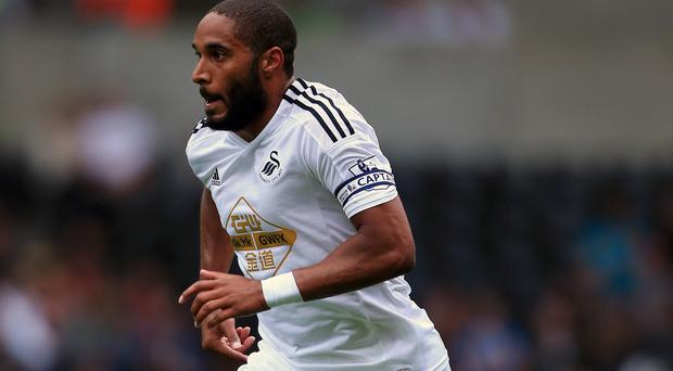 Ashley Williams will not allow Swansea to be distracted by the media focus on Louis van Gaal