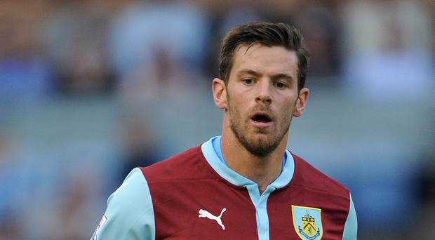 Lukas Jutkiewicz will hope to continue his fine pre-season form when Burnley play Chelsea on Monday