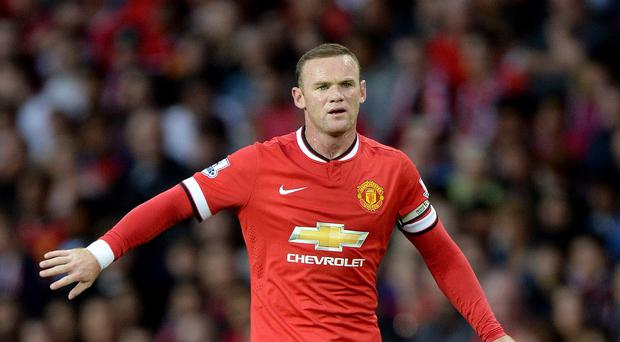 Wayne Rooney will lead out Manchester United this season as their captain