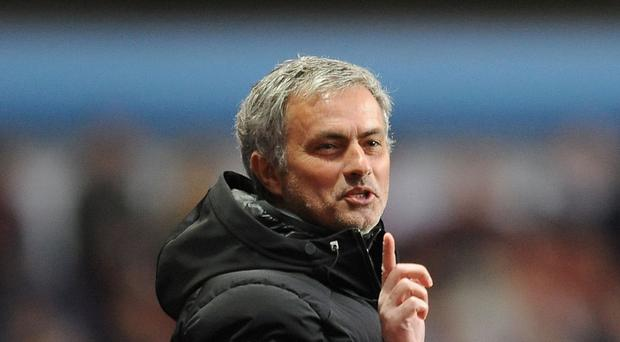 Jose Mourinho is happy to shoulder the trophy expectation at Chelsea this season