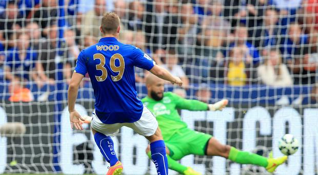 Chris Wood rescued a point for Leicester on their Premier League return