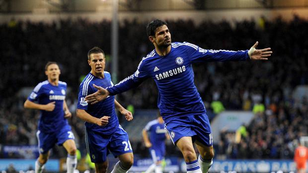 Diego Costa, right, celebrates scoring Chelsea's first goal during the 3-1 win over Burnley