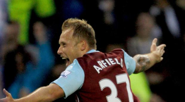 Scott Arfield had Burnley fans dreaming of a shock win over title favourites Chelsea