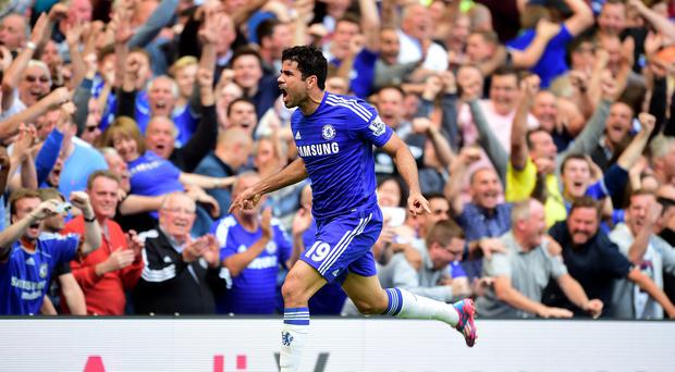 Diego Costa celebrates scoring the opening goal