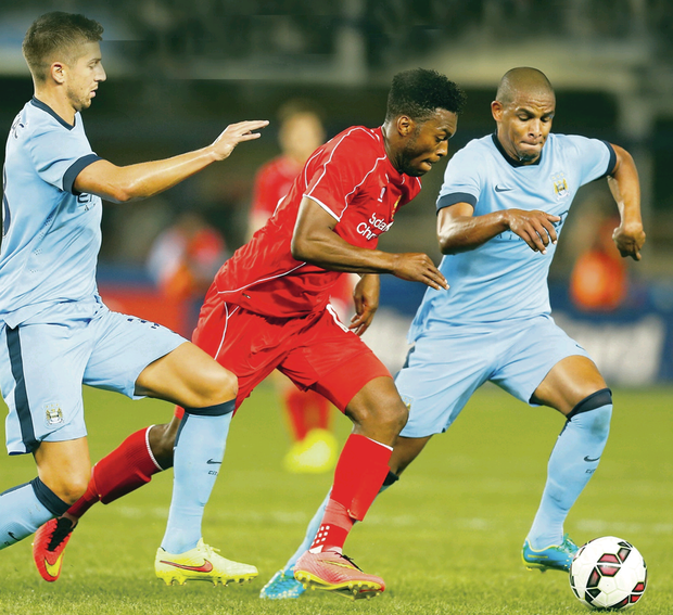 First glimpse: Liverpool ace Daniel Sturridge goes on the attack against City's Matija Nastasic and Fernando at a pre-season tour in the USA