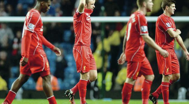 Dejected: beaten Liverpool players walk off the pitch last night