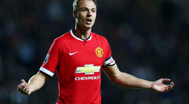 Nightmare performance: Jonny Evans had a match he'd rather forget against MK Dons