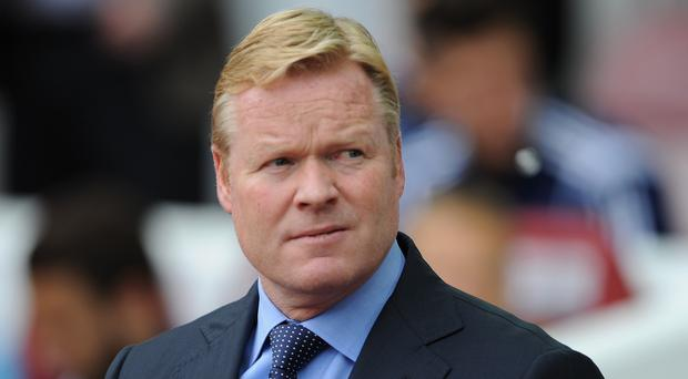 Ronald Koeman, pictured, would be only too happy to retain Morgan Schneiderlin's services