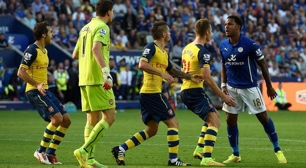 Fired up: Liam Moore of Leicester City clashes with Calum Chambers as Mathieu Debuchy tries to hold him back