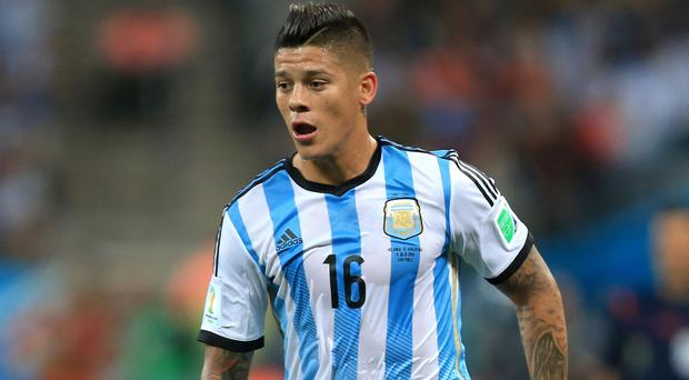 Marcos Rojo, pictured, is set to make his debut for Man Utd against QPR